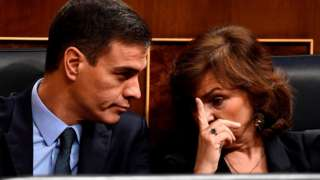 """Spanish Prime Minister Pedro Sanchez Deputy Prime Minister and Deputy Prime Minister and minister of equality Carmen Calvo attend a debate on the government""""s 2019 budget during a parliament session in Madrid on February 13, 2019"""