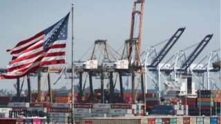 US flag flies at the port of Los Angeles
