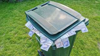 Bin with money in it