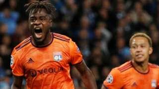 Maxwel Cornet celebrates scoring for Lyon against Manchester City