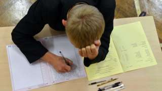 Schoolboy taking GCSE examination