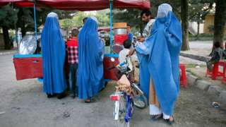 Afghan man with his three wives in Kabul.