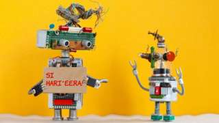 """A robot made of spare parts tells another: """"Si hari'eera!''"""
