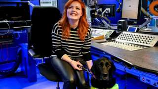Lucy Edwards and her dog Olga in the Radio 1 studio