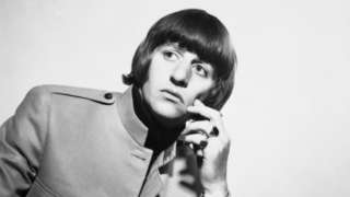 Black and white image of Ringo Starr of The Beatles