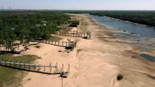 Aerial view of piers on an almost dry arm of the Parana river, during a historic drought, near Rosario, Santa Fe, Argentina, on August 22, 2021.