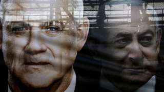 File photo showing Blue and White election poster featuring Benny Gantz (L) and Benjamin Netanyahu (R) in Tel Aviv, Israel (17 February 2020)