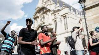 Undocumented migrants demonstrate to ask for the regularisation of their situation near the Pantheon in Paris