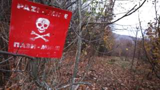 "A ""danger of death"" sign is seen at a minefield in a woodland in Sarajevo, Bosnia and Herzegovina on November 20, 2017."