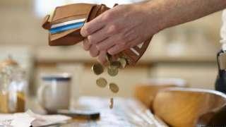 Money shaken from a wallet