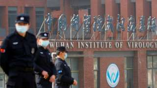 Security personnel keep watch outside Wuhan Institute of Virology
