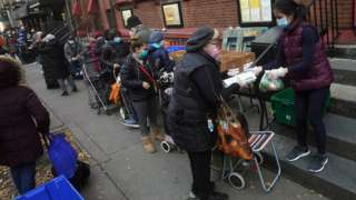 People wait in line at the St. Clements Food Pantry for food during the coronavirus disease (COVID-19) pandemic in the Manhattan borough of New York City, New York, U.S., December 11, 2020.