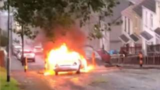 Cars on fire in Mayhill