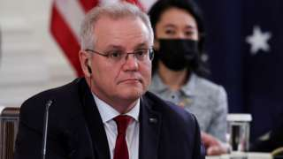 """Australia's Prime Minister Scott Morrison is seated with members of his delegation as he participates in a """"Quad nations"""" meeting at the Leaders"""" Summit of the Quadrilateral Framework at the White House in Washington, US, 24 September 2021"""