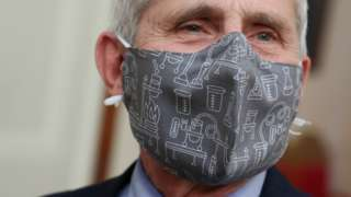NIH National Institute of Allergy and Infectious Diseases Director Anthony Fauci wears a lab equipment-themed mask