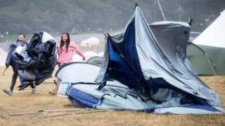 Battered tent after heavy rain at Camp Bestival