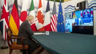 Prime Minister Boris Johnson in the Cabinet Room, Downing Street, London, hosting the G7 leaders for a virtual meeting to discuss worldwide distribtuion of coronavirus vaccines and preventing future pandemics.