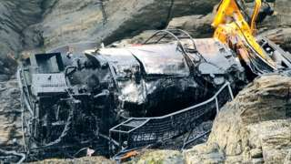Lorry reversed off cliff