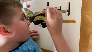 Jack painting an aeroplane