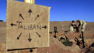 """A sign reading """"Taliban"""" at a US marine outpost in Afghanistan, 2001"""