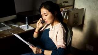 Woman paying bill