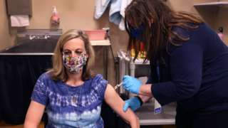 A female United Airlines employee receives a COVID-19 vaccine at United's onsite clinic at O'Hare International Airport on March 09, 2021 in Chicago, Illinois.