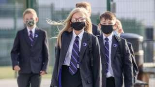 school children wearing face masks