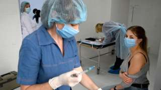 medical worker receives a dose of the Oxford/AstraZeneca vaccine against the coronavirus disease in Ukraine