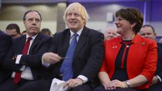 Boris Johnson, alongside Arlene Foster and Nigel Dodds, at the DUP party conference in 2018