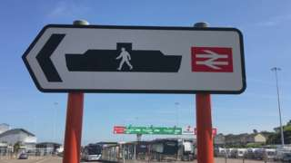 Sign for ferry and rail passengers at Holyhead Port