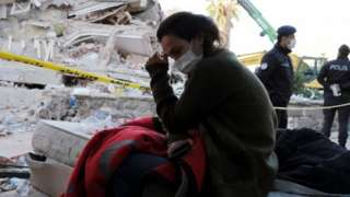 A woman reacts next to debris during rescue operations after an earthquake struck the Aegean Sea, in the coastal province of Izmir, Turkey, 31 October 2020.