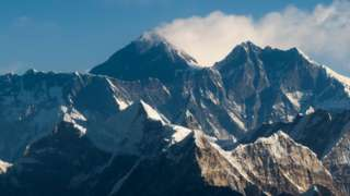 an aerial view of Mount Everest (C) and the Himalayan mountain range, some 140kms (87 miles) north-east of Kathmandu on February 7, 2020