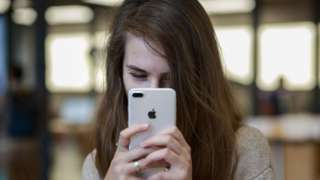 Woman takes a selfie with an iPhone