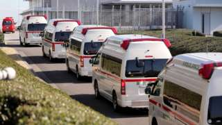 Ambulances arrive at Haneda airport in Tokyo earlier this year