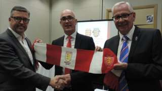Jersey FA vice-president Bradley Vowden (left), JFA chief executive Jean-Luc Desbois (centre) and Jersey Football Combination president Charlie Browne celebrate the merger