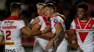 St Helens players celebrate Mark Percival scoring their fourth try against Hull FC
