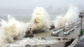 Waves lash over onto a shoreline in Mumbai on May 17, 2021, as Cyclone Tauktae, packing ferocious winds and threatening a destructive storm, surge bore down on India