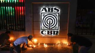 Filipinos light candles in symbolic solidarity outside ABS-CBN network headquarters in Quezon City, Metro Manila, Philippines, on 5 May 2020