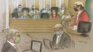 The jury at an Old Bailey trial, separated by plastic glass panels