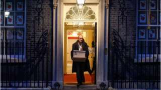 Dominic Cummings exits No 10 Downing Street carrying a cardboard box in November 2020