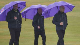 Umpires with umbrellas