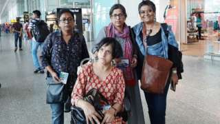 Disability activist Kuhu Das (standing left) and Jeeja Ghosh (seated) at Kolkata airport