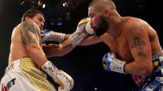 Tony Bellew hits Oleksandr Usyk with a right hand