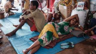 Ethiopian refugees who fled the Tigray conflict, rest in a makeshift shelter at Um Raquba reception camp in Sudan's eastern Gedaref state, on 3 December 2020
