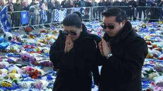 Vichai Srivaddhanaprabha's wife Aimon and son Aiyawatt at the scene