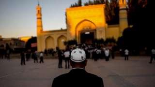 A man arrives for morning prayer in Kashgar, Xinjiang, a mostly Muslim region in north-western China