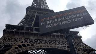A sign notifies the closure of the Eiffel Tower. 14 March 2020