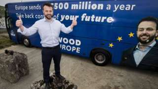 Colum Eastwood and campaign bus