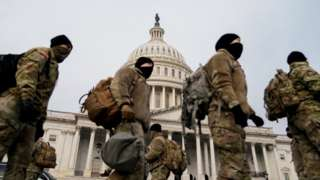 Members of the National Guard arrive to the U.S. Capitol days after supporters of U.S. President Donald Trump stormed the Capitol in Washington
