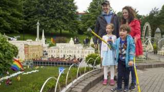 Joanna and Duncan Brett with their disabled son Sebby, seven and daughter Lottie, six, during a visit to Legoland